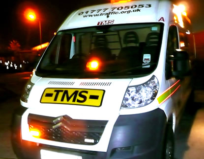 TMS Truck at Night Photo